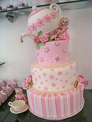 Tea party cake, oh this would be so cute at one of my Tea Parties....Ha Ha oh yeah like I have tea parties ;)