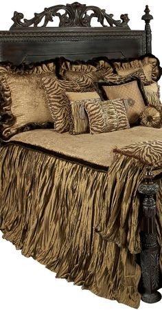 The Zanzibar blends together rich caramel colors and chocolate tones to achieve a balance that is neutral without sacrificing interest. The fabrics are a combination of soft chenille textured croc patterns, silks, faux mink, and a tiger patterned chenille. The pillows are embellished with decorative braids, beads, rope cording, and embroidered center medallions.