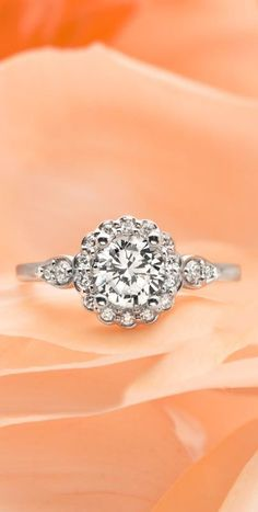Glittering diamond accents in pear shaped frames add a unique touch to this nature inspired ring.