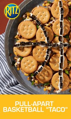 "Give your home team a bite of the action with this tasty MVP: the Pull-Apart Basketball ""Taco"". Make it by cooking ground beef with taco seasoning as directed on the package. Arrange RITZ Crackers, top-sides down, in a solid circle on a baking sheet. Spoon meat mixture over crackers and top with shredded Mexican cheese, green onions and sliced jalapenos. Cover with RITZ Crackers to form sandwiches, and bake until heated through. Garnish with sour cream and black olives and you're done!"