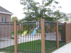 Semi private fencing with Iron panels and Trex posts.