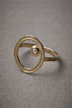 Unearthly Orbit Ring  $1,100.00              Inspired by a bright star making its rounds, a rose cut diamond ringed in gold has a celestial air. From Hélène Courtaigne. 18k yellow gold, rose cut diamond. Handmade in France.