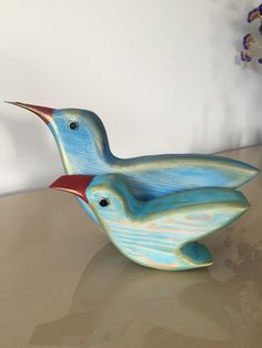 A personal favourite from my Etsy shop https://www.etsy.com/listing/249738856/lovely-wooden-birds-hand-painted-wooden