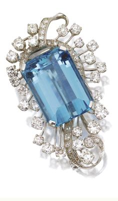 AQUAMARINE AND DIAMOND BROOCH The emerald-cut aquamarine weighing approximately 37.00 carats, old European-cut and single-cut diamonds weighing approximately 5.75 carats, mounted in platinum.