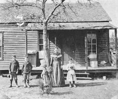 """Georgetta McFerrin & Children, at their home in Oak Cliff, 1892. The address for the McFerrin family was """"Thomas Hill"""". There was no street. Georgetta operated a curtin laundry business in Oak Cliff, Dallas, Texas. Photo and information courtesy The Hidden City, Oak Cliff Texas."""