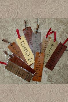 """- Decorative Leather Bookmark - Bookmark Measures 2"""" x 7"""" - Laser Engraved Scripture - Select from 6 Different Designs (From Left to Right) - 1 Corinthians 14:33 reads; For God is not the author of co"""