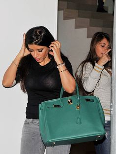Barcelona footballplayers Cesc Fabregas's wife Daniella Semaan and Leo Messi's wife Antonella Rocuzzo (R) are seen leaving Milan Pique first birthday party on January 23, 2014 in Barcelona, Spain.