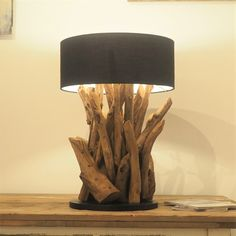 Ace:Twists of rustic teak roots form this very impressive reclaimed root lamp, giving your home that mystical look. Each root is unique in appearance as it curves from the base to the top of the lamp. Make very unique gifts and create warming mood lighting for the Winter months. Each piece of wood is unique so will vary slightly in shape and size. If you would like further images please contact us.
