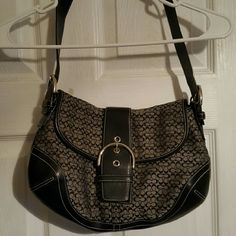 New Coach Purse This purse has been used 1 time. It is in perfect condition and was bought from a Coach outlet. Plenty of room for all your purse accessories! Coach Bags Shoulder Bags