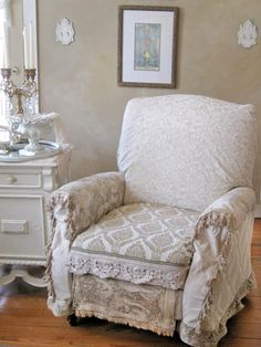 Plush looking chair with vintage covering - shabby chic living room.