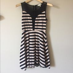 Stripped skater mesh dress Cute fit b flare with flattering strips that go down the to the side. Cut out mesh for a sexy touch. Only worn twice. **tip- since you have to go braless and don't want to use those dumb sticky boobs that fall off just use the swim suit padding out of your swim suit with fashion tap and have a fun night! Dresses