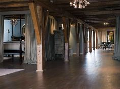 amsterdam loft in a converted warehouse bordering a canal.  they used linen curtains to divide the space.  (sigh).