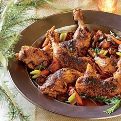 Coq au Vin | This variation on the classic French wine-braised chicken uses white instead of red wine, giving the finished dish a lovely golden hue.