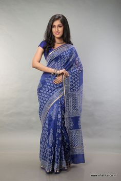Inspired by the beauty of ancient rangoli designs, Prarthana Ink Blue Bagh Printed Cotton Saree has a traditional charm to it. With entire block printing done in white on an elegant blue background, the charm, grace and poise of Bagh Prints comes out alive on this Silk Cotton saree.