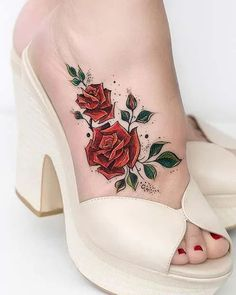 Red roses are beautiful and are a symbol of love and romance. So, it is no surprise that these flowers have inspired tattoo designs. This foot tattoo features two artistic red roses. As you can see, the roses look feminine and elegant. You can take inspiration from this design and have two roses or maybe try one or three. Cute Foot Tattoos, Ankle Tattoos, Small Tattoos, Sleeve Tattoos, Tattoo Arm, Snake Tattoo, Awesome Tattoos, Rose Tattoos For Women, Tattoo Designs For Women