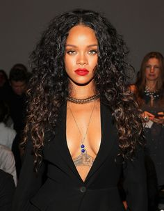 Rihanna is so stunning with a red lip and center part