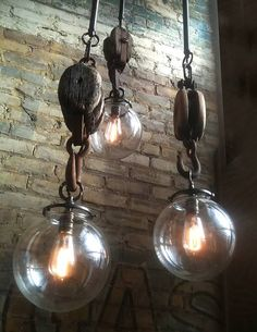 Vintage Industrial Decor Becoming one of Omega Lighting Design's most popular custom builds. made from vintage barn hooks, these rustic lights work great in restaurants, honkytonks, and wine tasting party rooms. - Upcycled lighting has never been as chic. Vintage Industrial Lighting, Industrial Light Fixtures, Rustic Lighting, Home Lighting, Lighting Design, Industrial Lamps, Industrial Interiors, Industrial Office, Modern Industrial