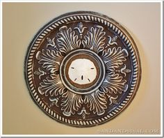 Ceiling medallion as round frame = great idea and super light-weight for hanging. From Kim at Sand and Sisal.