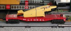 Lionel postwar # 6800 Airplane flatcar with yellow over black airplane.