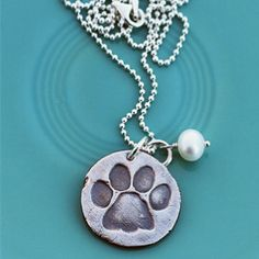 Vintage paw print necklace from The Vintage Pearl...sign me up!