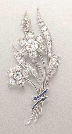 Diamond and Synthetic Sapphire Flower Brooch Platinum, 2 diamonds ap. 1.25 cts. & .30 ct., 37 diamonds ap. 3.00 cts., c. 1945, ap. 7.6 dwt.