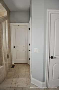 The wall color is Gray Wisp by Benjamin Moore.  It's almost a perfect match to Restoration Hardware's Silver Sage