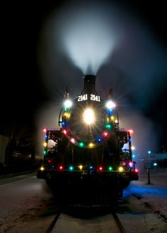 Train decorated for Christmas! I imagine kids would think it was the Polar Express... & that's magical to them.