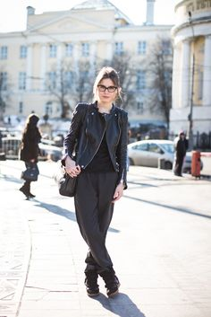 cat eye glasses with leather jacket, slouchy pants, & sneakers