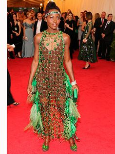 Met Ball 2014: Company's Best Dressed! Making a statement with feathers and embellishment, you couldn't miss Lupita Nyong'o!