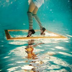Alice in Waterland by Elena Kalis. This is kind of how I imagine poor Celeste, except she didn't voluntarily wander down the rabbit hole.