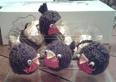 Knitted Robin holds one Ferrero Rocher chocolate. A sweet treat for Christmas.