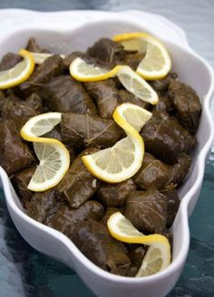 Dolmades (Stuffed Grape leaves). I love these things and will make them. I will let you know how they turn out.