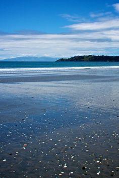 Onetangi Beach boasts of white sand. Waiheke Island near Auckland New Zealand Waiheke Island, Auckland New Zealand, Globe Travel, Island Beach, Travel Scrapbook, Travel Photos, Travel Photography, Around The Worlds, Adventure