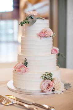 Romantic wedding cake, four tiers, light pink roses // Allison Kuhn Photography