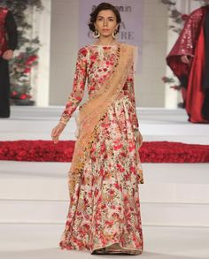 Ivory Lehenga with multicolor thread embroidered floral motifs. Matching full sleeves blouse with floral motifs. Vintage peach dupatta with floral embroidery and key hole back..Wash care: Dry clean only.Disclaimer: There might be a slight color variation in this item as this image is from the actual runway show..