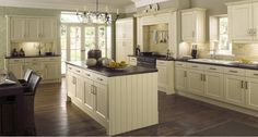 Creamy White Kitchen. Beautiful creamy white paint color for kitchen cabinets. #CreamyKitchen #KitchenPaintColor