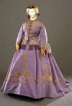 Formal dress, Italian, 1867. Three pieces (jacket, bodice and skirt) in mauve taffeta, with decorations in yellow gold thread. Photo: Antonio Quattrone. Collection Galleria del Costume di Palazzo Pitti, Florence