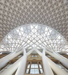 The new concourse at King's Cross station, designed by John McAslan and Partners, sits between King's Cross and the recently renovated St Pancras station next door