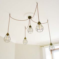 This DIYer used individual SLÄTTBO cage lights to create an expensive-looking cluster pendant @kbarlee_