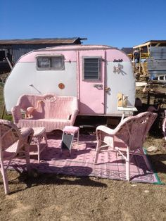 Pink vintage trailer,  the pink wicker makes this even greater:)
