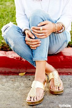 Gold on gold! We're loving this simple summer outfit, topped with tons of gold accessories. The cork sandals, mismatched rings and wristfuls of bangles all have a relaxed, bohemian vibe, making them great complements to ripped denim and a white cotton blouse.