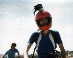 """DP Mark Schulze wearing his helmet cam invention that he used in the production of the world's first mountain-bike instructional video, """"The Great Mountain Biking Video,"""" 1988 (Photo by Patty Mooney of San Diego video production company Crystal Pyramid Productions - http://sandiegovideoproduction.com/mountain-bike-helmet-cam/)"""