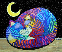 A colorful rainbow striped cat in the moonlight
