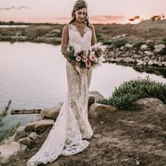 A Golden Sunset Bridal Portrait | Dan Bushkin Las Vegas Wedding Photography | Taken by the waters edge and the setting sun, an intimate wedding portrait of a stunning bride in a white lace wedding dress and her, half up wedding hairstyle and a romantic summer wedding bouquet with blooms of blush and white with greenery. | Summer Bride | Evening Wedding Portrait #bridalportrait #weddingdress #sunsetweddingphotography #weddingphotography #lasvegasweddingphotographer Beach Elopement, Elopement Ideas, Elopement Inspiration, Las Vegas Wedding Photographers, Las Vegas Weddings, Destination Weddings, Summer Wedding Bouquets, Wedding Flowers, Wedding Dresses