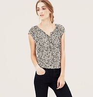 Filigree Lace Print Henley Tee Blouse - A step up from a casual tee, we dressed up this go-to with shirred and smocked trim - and an offbeat chic lace print. Split scoop neck. Short raglan sleeves. Henley button placket.