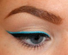 Layer your usual black liner over a neon base, using a white liner base.