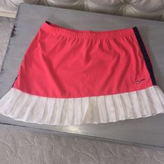 Nike tennis skirt NWOT size med. Pink w lace trim Nike tennis skirt .. Does not have built in shorts Nike Skirts