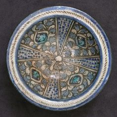 Bowl Date: 14th century Geography: Iran, probably Kashan Culture: Islamic Medium: Stonepaste; underglaze painted (Sultanabad ware) Dimensions: H. 3 1/4 in. (8.3 cm) Diam. 6 5/8 in. (16.8 cm) Classification: Ceramics Credit Line: The Grinnell Collection, Bequest of William Milne Grinnell, 1920 Accession Number: 20.120.7