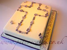 Baptism cake...I like the cross made with mini flowers.