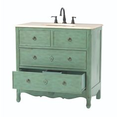The Keys Vanity in Distressed Aqua Marine has a vintage-inspired style fits beautifulliy in a transitional, rustic or farmhouse decor. this vanity's polished beige marble vanity top beautifully complements the distressed finish.